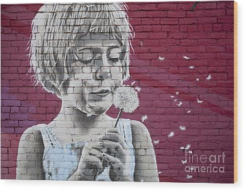 Girl Blowing A Dandelion Wood Print by Chris Dutton