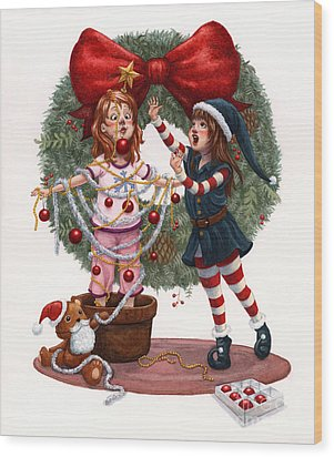 Girls Decorating For Christmas Wood Print by Isabella Kung