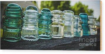 Glass Insulator Row Wood Print by Deborah Smolinske