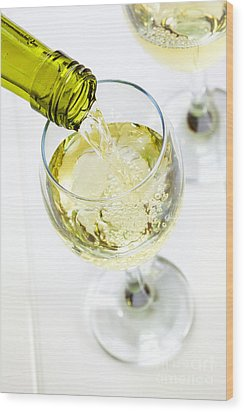Glass Of White Wine Being Poured Wood Print by Colin and Linda McKie