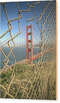Golden Gate Through The Fence Wood Print by Scott Norris