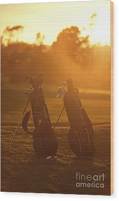 Golf Bags At Sunset Wood Print
