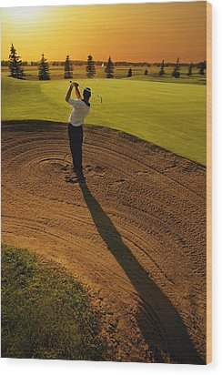 Golfer Taking A Swing From A Golf Bunker Wood Print by Darren Greenwood