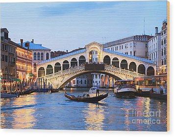 Gondola In Front Of Rialto Bridge At Dusk Venice Italy Wood Print by Matteo Colombo