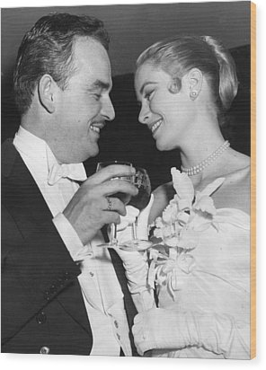 Grace Kelly Toasts With Husband Wood Print by Retro Images Archive