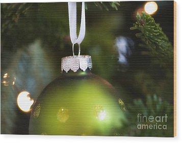 Green Ornament Hanging In Tree Wood Print by Birgit Tyrrell