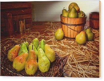 Green Pears In Rustic Basket Wood Print by Olivier Le Queinec