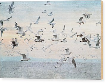 Gulls Flying Over The Ocean Wood Print by Peggy Collins