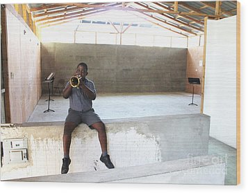 Haitian Boy Plays Trumpet Wood Print by Jim Wright