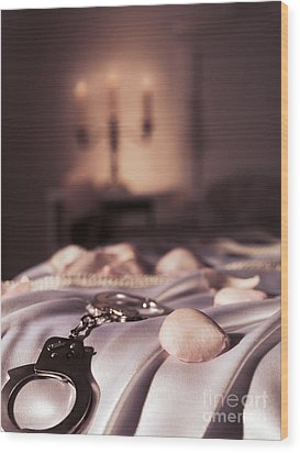 Handcuffs Ropes And Rose Petals On Bed Bdsm Sex Romantic Concept Wood Print by Oleksiy Maksymenko