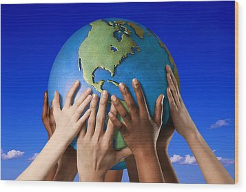 Hands On A Globe Wood Print by Don Hammond