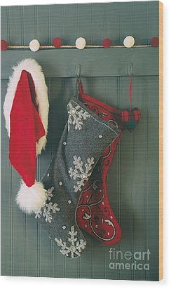 Wood Print featuring the photograph Hanging Stockings And Santa Hat On Hook by Sandra Cunningham