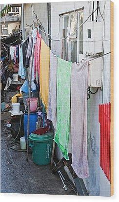 Hanging Towels Wood Print by Tom Gowanlock