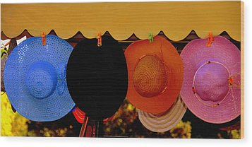Wood Print featuring the photograph Hats Of Many Colors by Caroline Stella