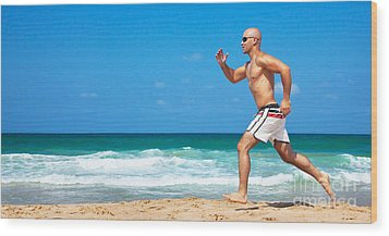 Healthy Man Running On The Beach Wood Print by Anna Om