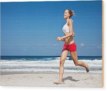 Healthy Woman Running On The Beach Wood Print by Anna Om