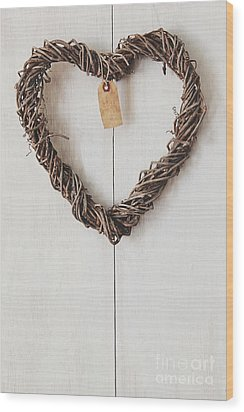 Wood Print featuring the photograph Heart Wreath Hanging On Wood Background by Sandra Cunningham