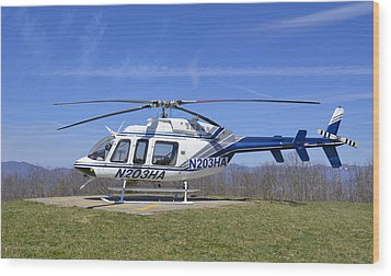 Helicopter On A Mountain Wood Print by Susan Leggett