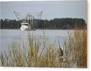 Heron Wading With Passing Shrimp Boat Wood Print