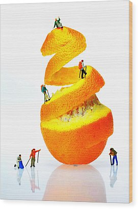 Hikers Climbing Orange Mountain Wood Print by Paul Ge