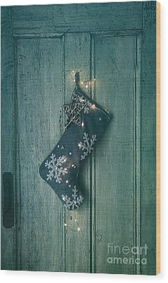Wood Print featuring the photograph Holiday Stocking With Lights Hanging On Old Door by Sandra Cunningham