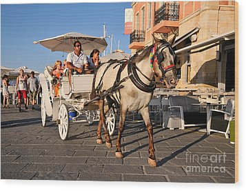 Horse Carriage At The Old Port Of Chania Wood Print by George Atsametakis