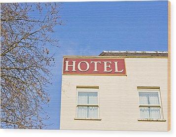 Hotel Wood Print by Tom Gowanlock