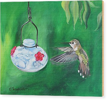 Hummingbird And The Feeder Wood Print