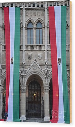 Hungary Flag Hanging At Parliament Budapest Wood Print by Imran Ahmed