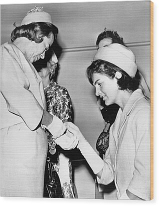 Jackie Inspects Gold Bracelet Wood Print by Underwood Archives