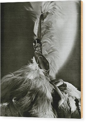 Josephine Baker Wearing A Feathered Cape Wood Print by George Hoyningen-Huene