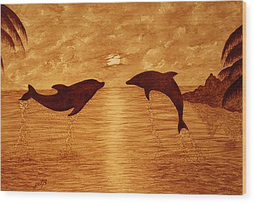 Jumping Dolphins At Sunset Wood Print by Georgeta  Blanaru
