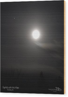 Jupiter With The Moon Wood Print by Guy Hoffman