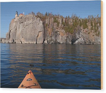 Wood Print featuring the photograph Kayaking Beneath The Light by James Peterson