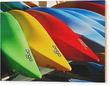 Kayaks Await Wood Print by James Kirkikis