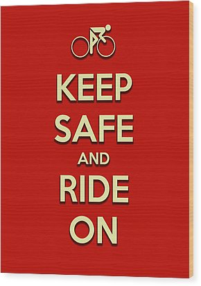 Keep Safe And Ride On Wood Print by Brian Carson