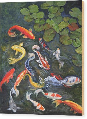 Koi Among The Lily Pads Wood Print