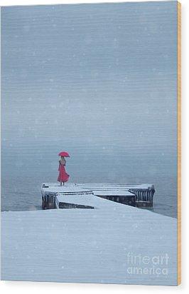 Lady In Red On Snowy Pier Wood Print by Jill Battaglia