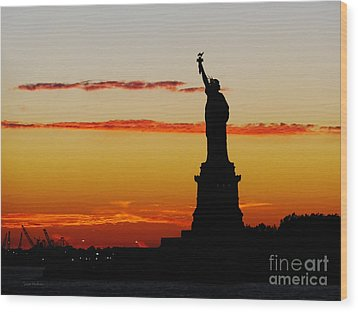 Wood Print featuring the photograph Lady Liberty At Sunset by Susan Wiedmann