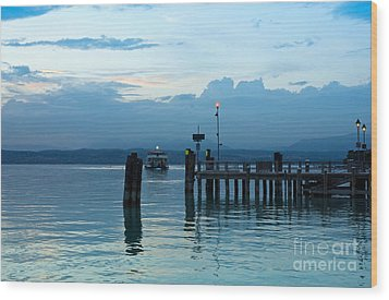 Lake Garda Pier And The Last Ferry For The Day Wood Print by Kiril Stanchev