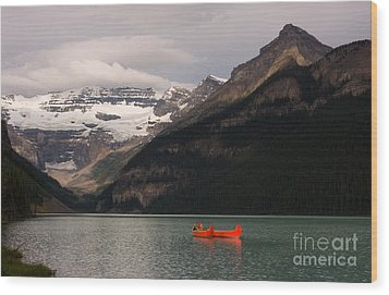 Wood Print featuring the photograph Lake Louise Canoes by Chris Scroggins