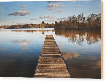 Landscape Of Fishing Jetty On Calm Lake At Sunset With Reflectio Wood Print by Matthew Gibson