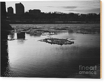 large chunks of floating ice on the south saskatchewan river in winter flowing through downtown Sask Wood Print by Joe Fox