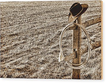 Lasso And Hat On Fence Post Wood Print by Olivier Le Queinec