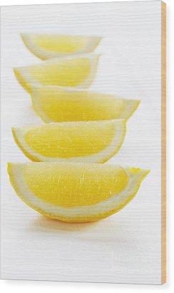 Lemon Wedges On White Background Wood Print