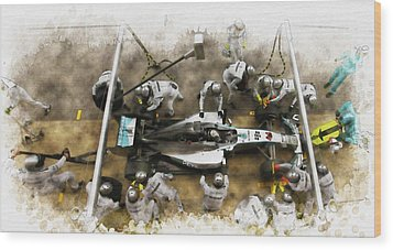 Lewis Hamilton Of Britain Service The Car At Pit Stop Wood Print