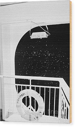 lifebelt on board the hurtigruten ship ms midnatsol at night in winter in Tromso troms Norway europe Wood Print by Joe Fox