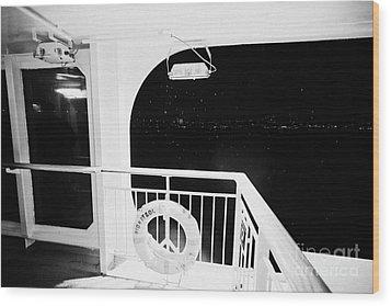 lifebelt on board the hurtigruten ship ms midnatsol at night in winter in Tromso troms Norway Wood Print by Joe Fox