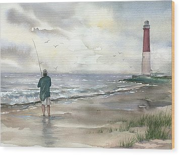 Lighthouse And Fisherman Wood Print by Beth Kantor