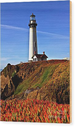 Wood Print featuring the photograph Lighthouse With Red Blooms by Charles Lupica
